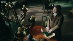 Mr. Norrell casting his spell to destroy Jonathan Strange's book.